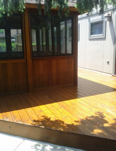 AFTER Stained Screened Porch Deck